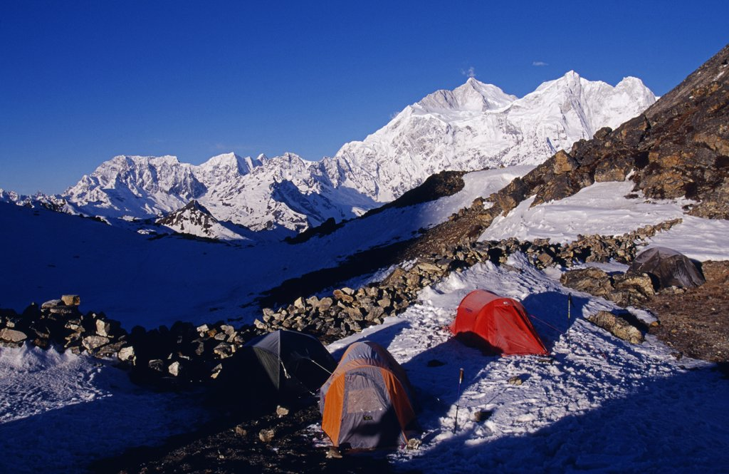 Stock Photo: 4272-32450 Tibet, Chomolungma, Kangshung Valley. Camping on the Sho La Pass on the way into the Kangshung Valley on the East side of Mount Everest. The Kangshung Valley was used by mountaineering expeditions seeking to climb Mount Everest in 1920's because Nepal was closed to foreigners