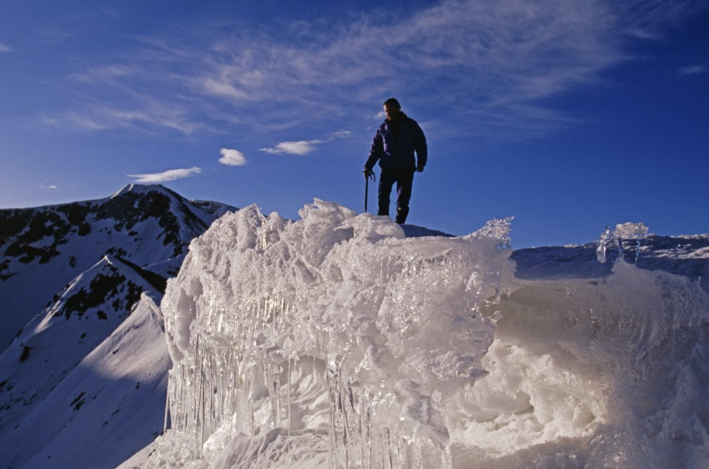 Tibet, Chomolungma, Kangshung Valley. Climbing along an ice ridge near the Sho La Pass on the way into the Kangshung Valley on the East side of Mount Everest. The Kangshung Valley was used by mountaineering expeditions seeking to climb Mount Everest in 1920's because Nepal was closed to foreigners. : Stock Photo