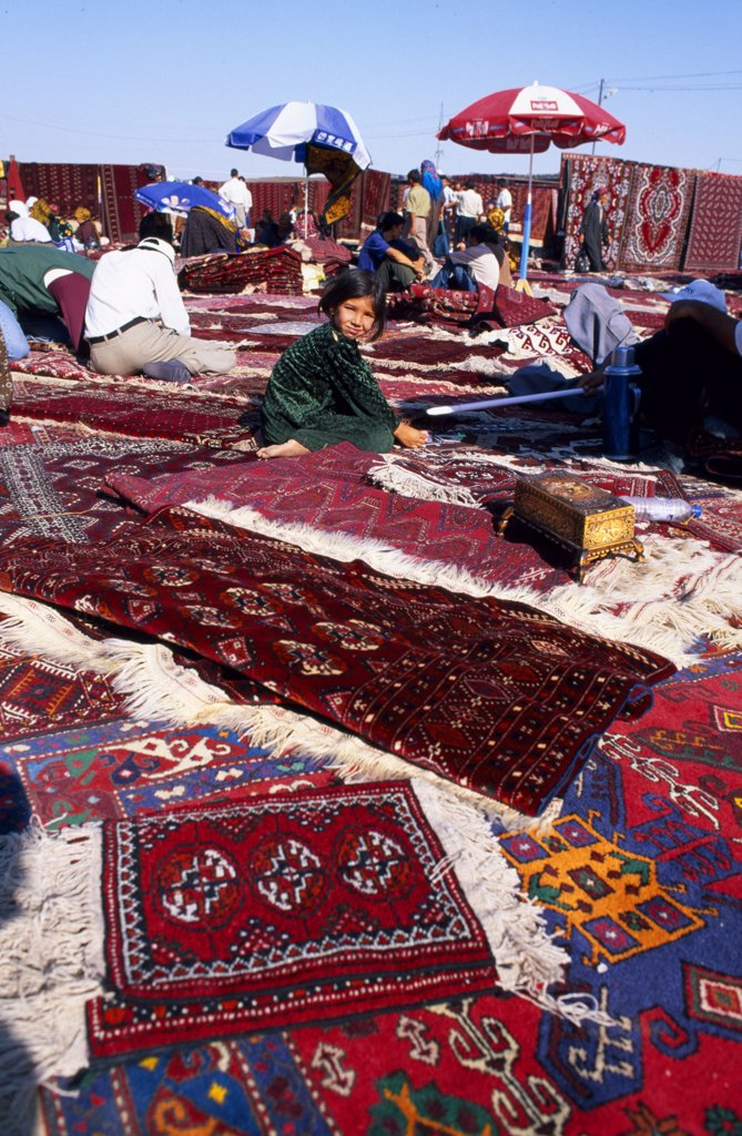 Stock Photo: 4272-32475 Carpets and rugs laid out for sale at  the Tolkuchka Bazaar.
