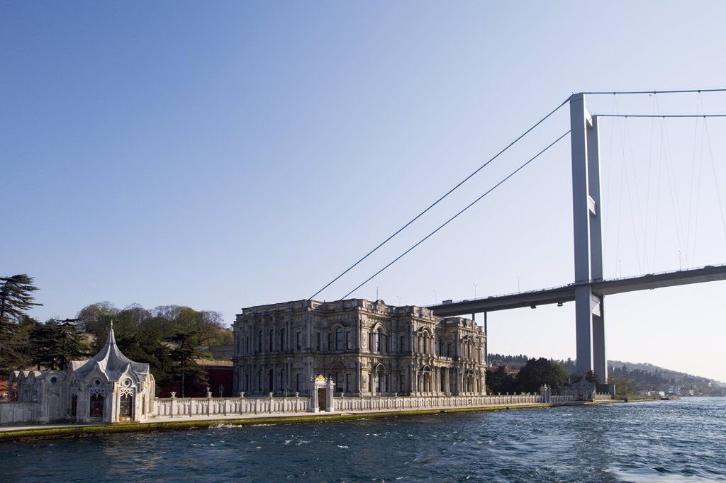 The Baylerbeyi Palace stands on the Asian side of the Bosphorus at Istanbul, Turkey, underneath the giant Ataturk Bridge. : Stock Photo