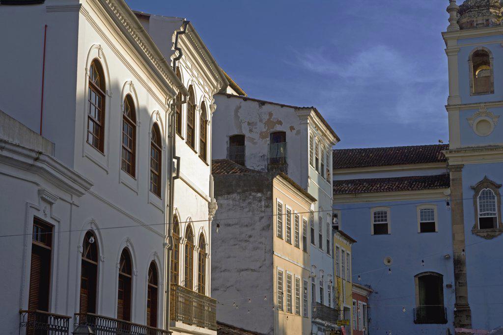 Stock Photo: 4272-3268 Brazil, Bahia, Salvador. Within the historic Old City, a UNESCO World Heritage site, the side facade of the Igreja Nossa Senhora dos Ros_'rios dos Pretos, Pelourinho, and adjoining residential buildings.
