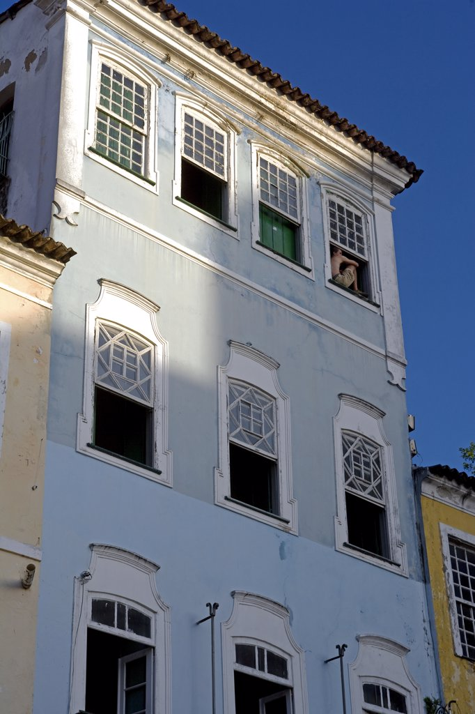 Brazil, Bahia, Salvador. Within the historic Old City, a UNESCO World Heritage site, near the Sao Francisco Church and Convent of Salvador, detail of the renovated classic windows, shutters and facade of colonial style town houses. : Stock Photo