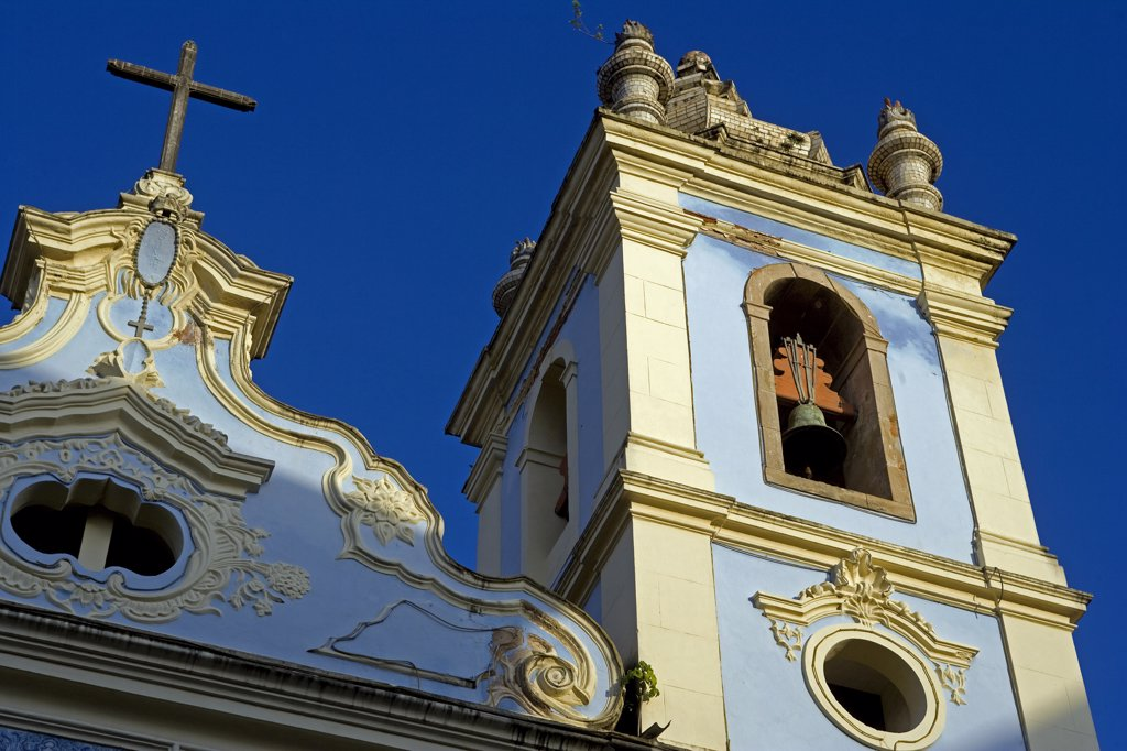 Stock Photo: 4272-3270 Brazil, Bahia, Salvador. Within the historic Old City, a UNESCO World Heritage site, the front facade and bell tower of the Igreja Nossa Senhora dos Ros_'rios dos Pretos, Pelourinho.