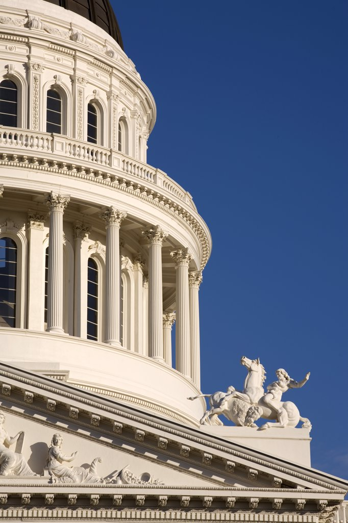 United States, California; Sacramento. Close-up of the State Capitol building showing part of the dome and pediment on the west facade. : Stock Photo