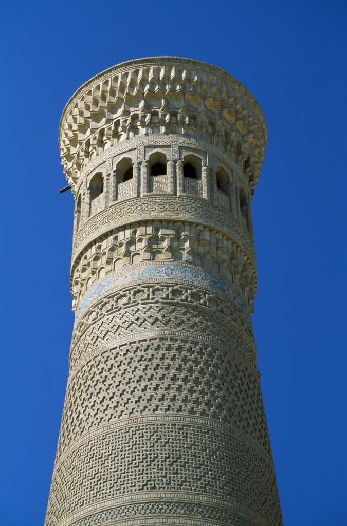 The Kalan minaret.  Built in 1121-22AD during the reign of the Kharakhanid ruler Arslan Khan Muhammed, the minaret collapsed destroying a large section of the mosque.  It was rebuilt during Arslan Khan Muhammed's life-time.  Almost 50 m tall it so impressed Genghis Khan, he ordered that it be spared when Bukhara was pillaged in 1220AD. : Stock Photo