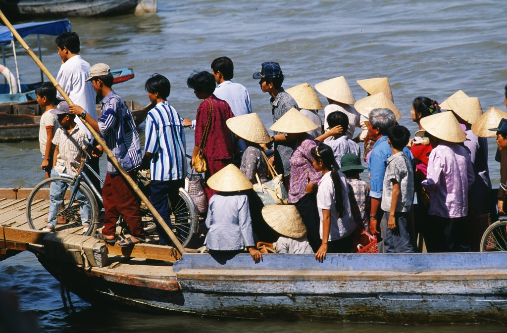 Boat ferrying passengers across the Mekong River to the town of Cantho : Stock Photo