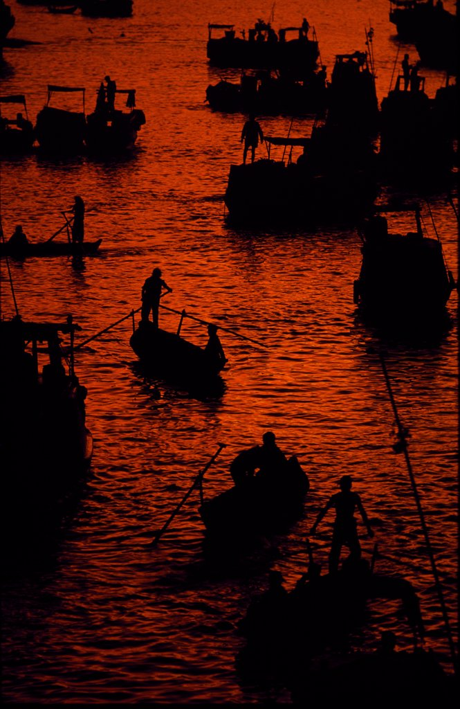Stock Photo: 4272-34953 Sunrise at the floating market on the Mekong River, near the town of Cantho.&