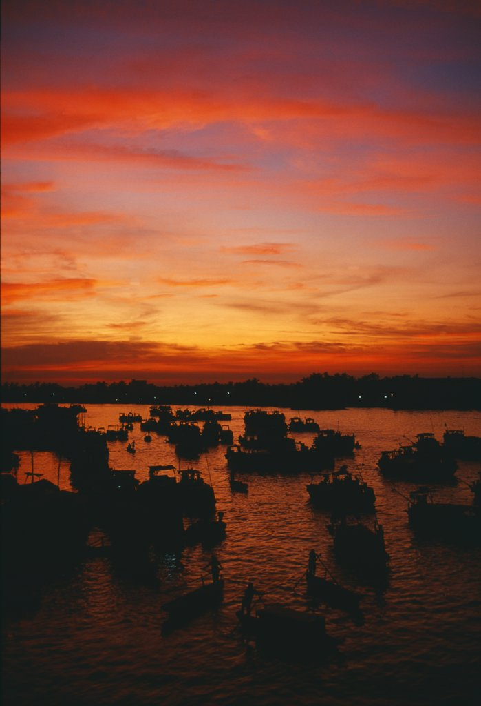 Stock Photo: 4272-34954 Sunrise at the floating market on the Mekong River, near the town of Cantho
