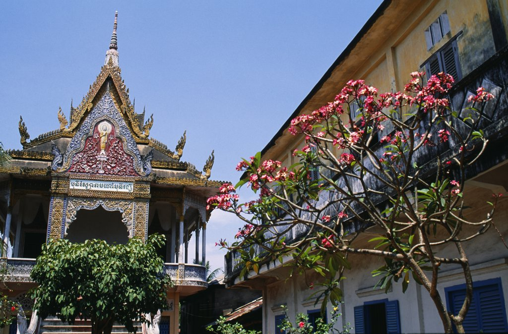 Stock Photo: 4272-34955 Munirangsyaram Pagoda in the town of Cantho.A Khmer Pagoda built in 1946. The upper hall above the steps lined with three-headed snakes, contains two statues of Sakyamuni, one seated and one reclining.