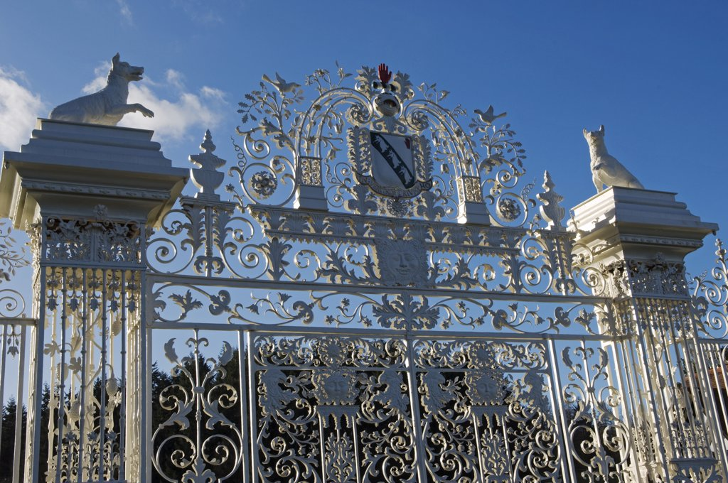 Stock Photo: 4272-35027 Wales, Wrexham, Chirk. The Baroque gates of Chirk Castle, wrought by the Davies brothers of Bersham around 1712 AD, are topped by the Myddelton coat of arms and a pair of wolves.