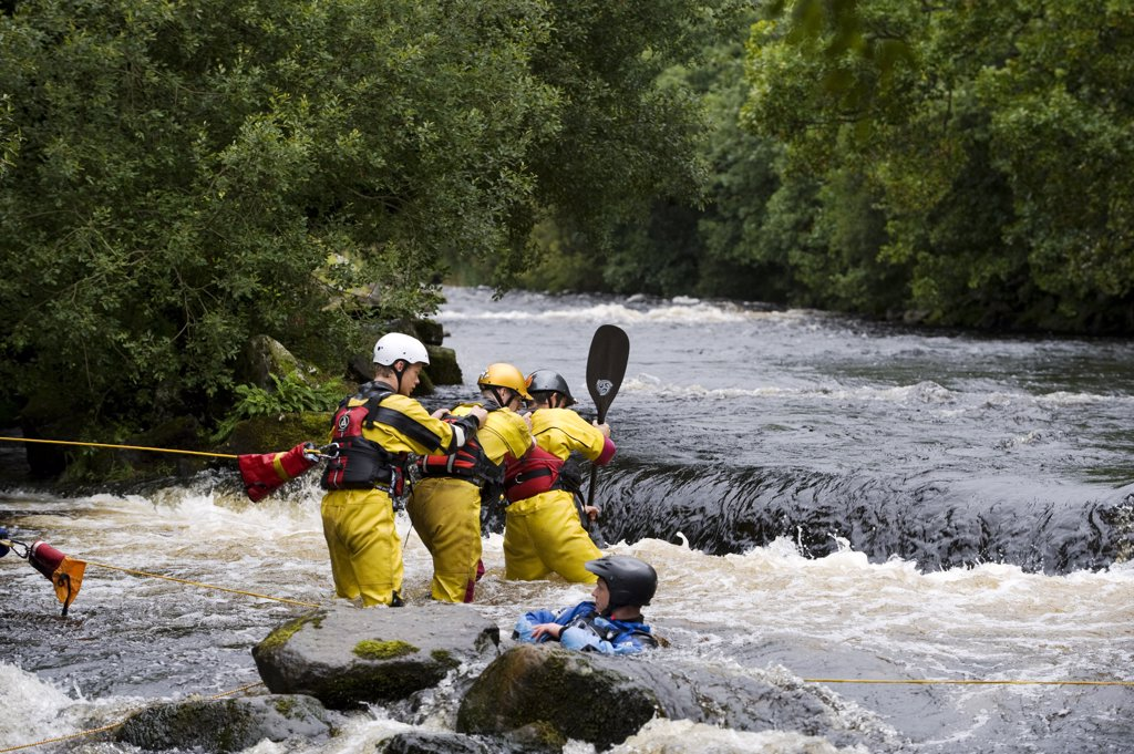 Stock Photo: 4272-35175 Wales, Gwynedd, Bala. An exercise to simulate rescuing a capsized canoeist at the National Whitewater Centre