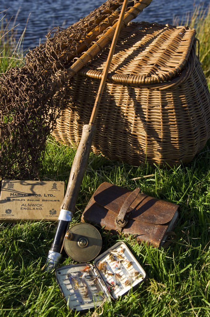 Stock Photo: 4272-35193 UK, Wales, Conwy. A split-cane fly rod and traditional fly-fishing equipment beside a trout lake in North Wales