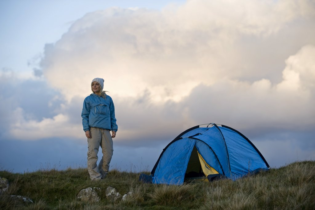Stock Photo: 4272-35551 North Wales, Snowdonia, Gilar Farm.  Woman camping in the wild.