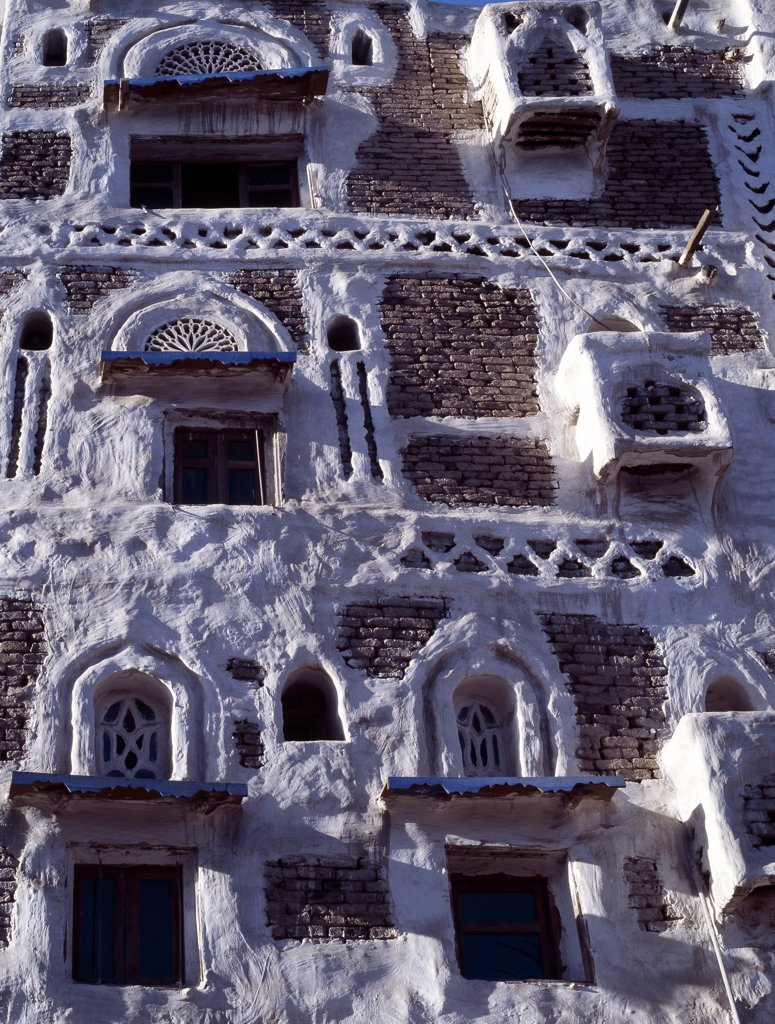 Surrounded by a massive 20 to 30 foot high wall, old Sanaa is one of the worlds oldest inhabited cities.  Several stone and brick buildings date back to the 11th Century AD, many are over 400 years old.  Modern buildings follow the same 1,000-year-old distinctive Yemeni architectural style. : Stock Photo