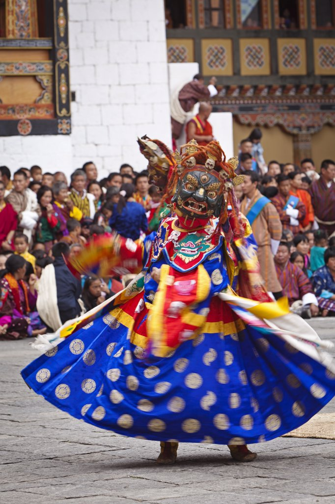 Stock Photo: 4272-36474 Masked dancing at Trashi Chhoe Dzong, a monastery now also housing the secretariat, the throne room and offices of the King.