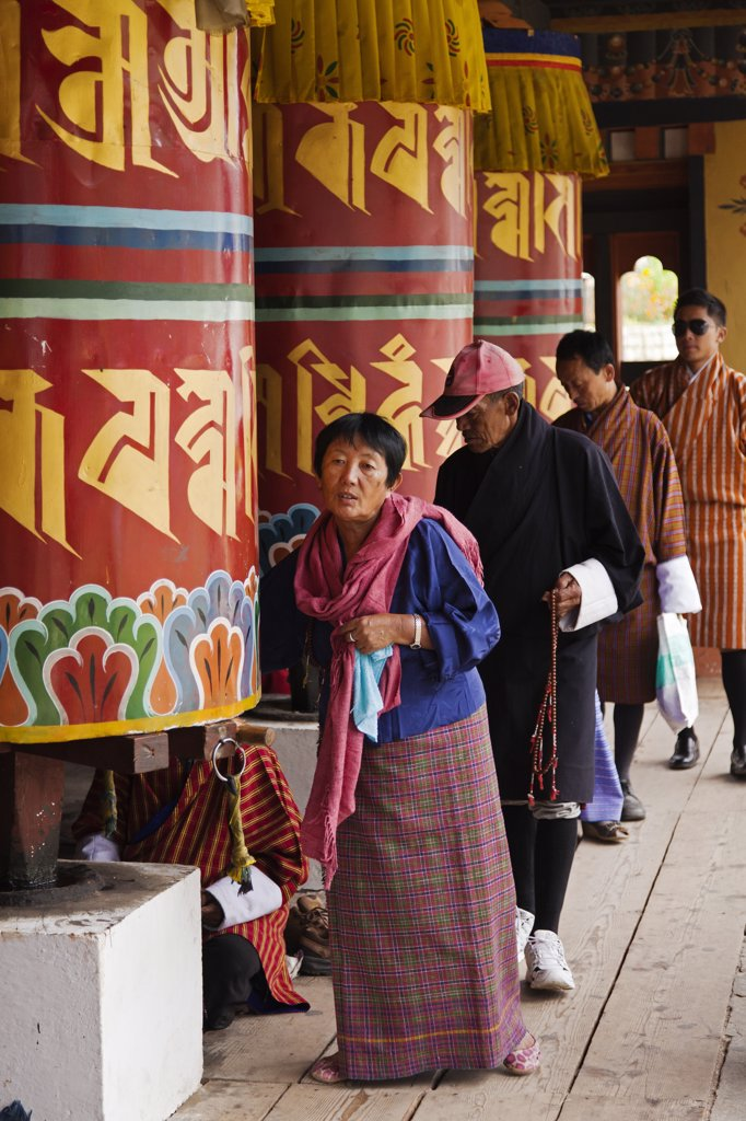 Stock Photo: 4272-36490 Turning the giant prayer wheels at the National Memorial Chorten in Thimphu.