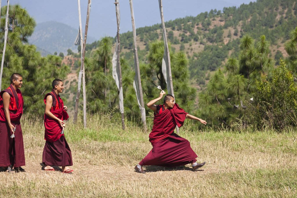 Monks playing darts at Chimi Lhakhang, built in 1499 by the 14th Drukpa hierarch, Ngawang Choegyel. : Stock Photo