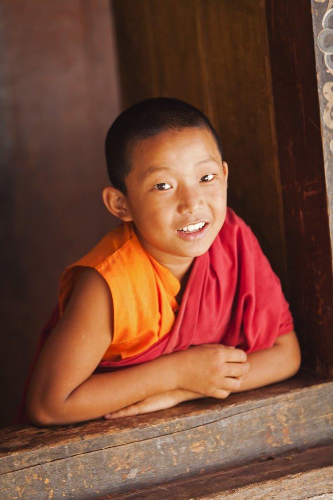 Young monk at Chimi Lhakhang, built in 1499 by the 14th Drukpa hierarch, Ngawang Choegyel. : Stock Photo
