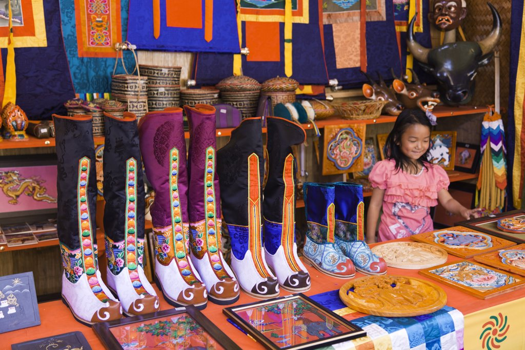 Traditional knee-length boots known as Tsholham, worn by Bhutanese men during important ceremonial occasions, for sale in a shop in Thimphu. : Stock Photo