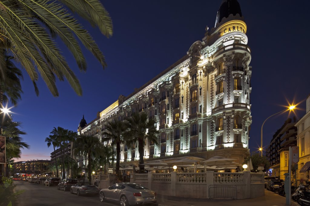 Stock Photo: 4272-37016 Cannes, Provence-Alpes-Cote d'Azur, France. View of the InterContinental Carlton Hotel from the La Croisette premenade by night