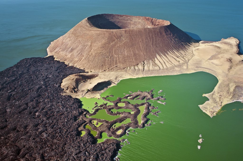 Stock Photo: 4272-37502 The perfectly shaped volcanic cone called Nabuyatom juts into the jade waters of Lake Turkana at the inhospitable southern end of the lake, known as Von Hohnel Bay.