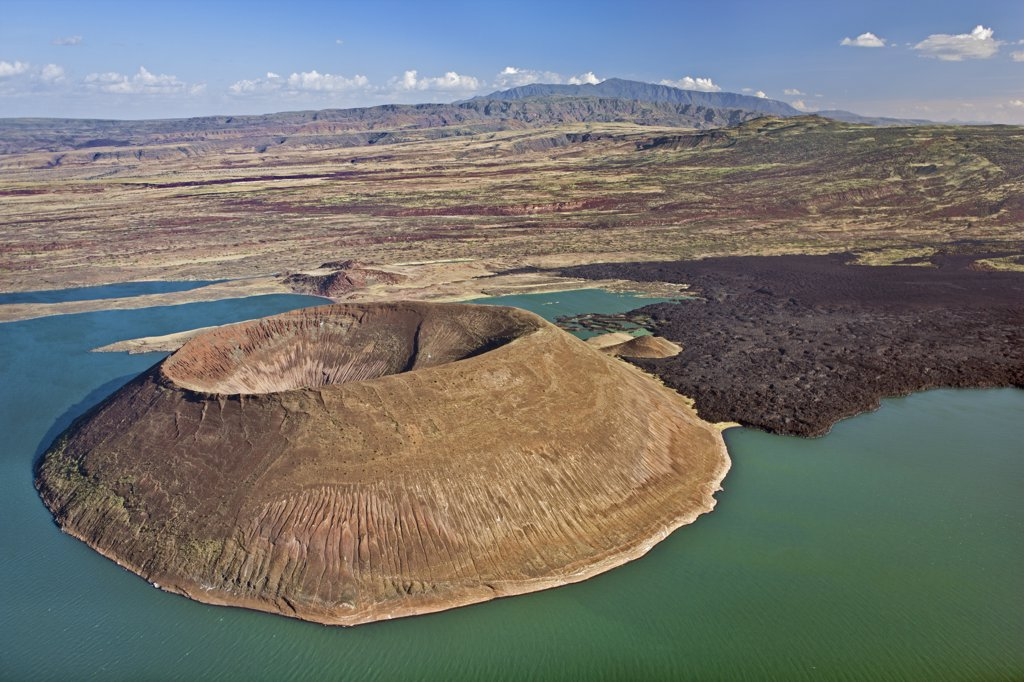 The perfectly shaped volcanic cone called Nabuyatom juts into the jade waters of Lake Turkana. : Stock Photo