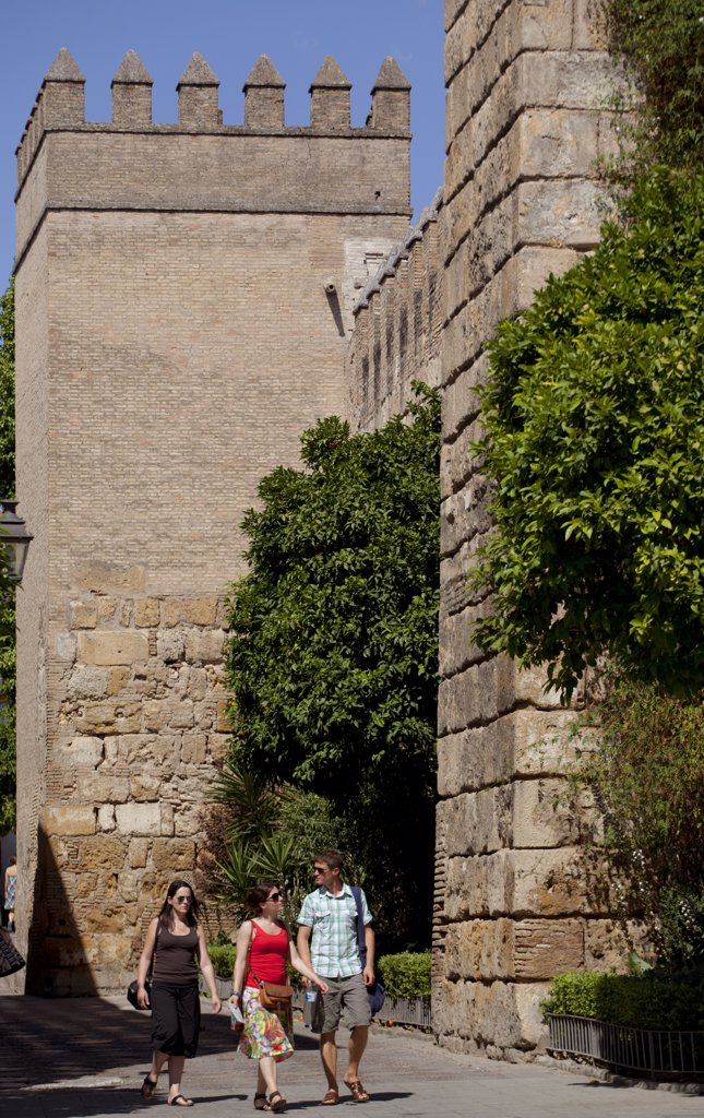 Stock Photo: 4272-38089 Spain, Andalusia, Seville; Tourists walking in front of fortified walls in the historic centre