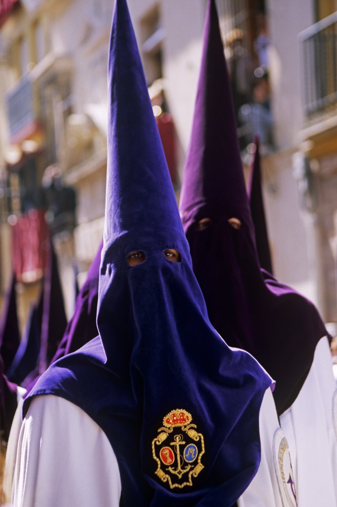 Stock Photo: 4272-38100 Spain, Andalusia, Seville. Nazarenos during Semana Santa processions