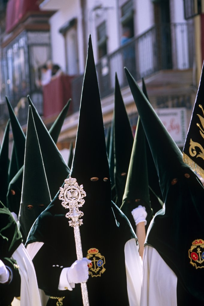 Stock Photo: 4272-38102 Spain, Andalusia, Seville. Nazarenos during Semana Santa processions