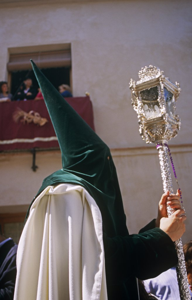 Spain, Andalusia, Seville. Nazarenos during Semana Santa processions : Stock Photo