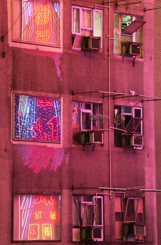 Stock Photo: 4272-3818 The neon lights of Kowloon reflected in the windows of apartment blocks, Hong Kong.