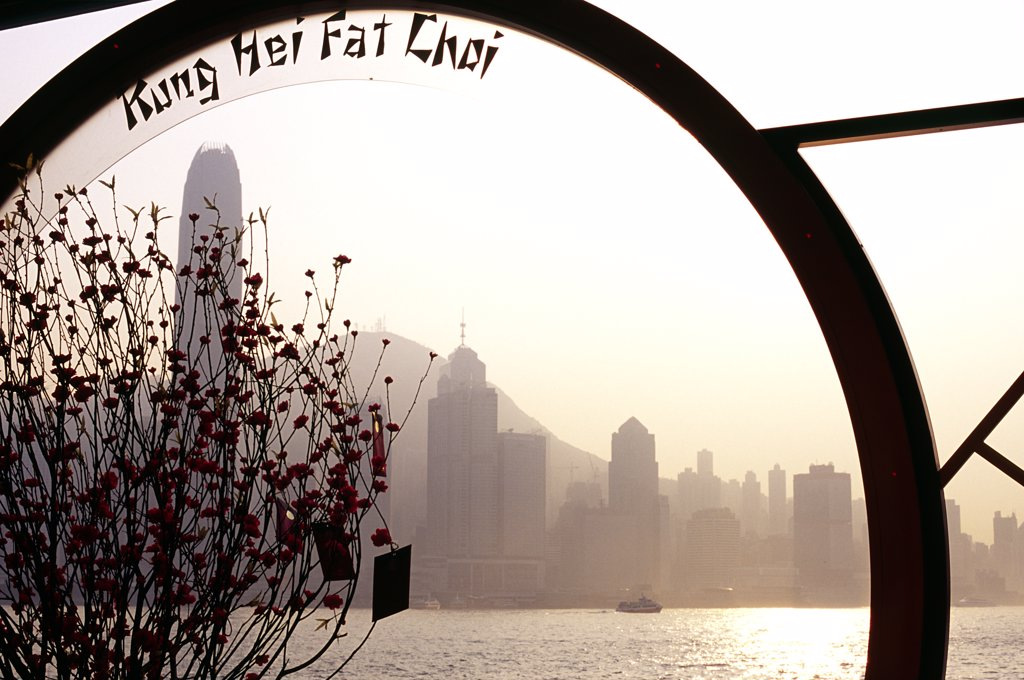 A pavillion on the Kowloon waterfront, overlooking Victoria Harbour, displays a Chinese New Year message. : Stock Photo