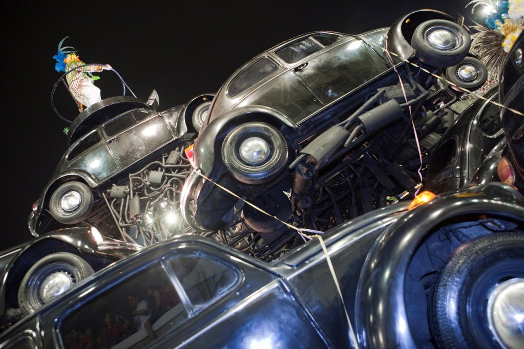 Stock Photo: 4272-39870 South America, Rio de Janeiro, Rio de Janeiro city, a float made from black VW beetles at carnival in the Sambadrome Marques de Sapucai