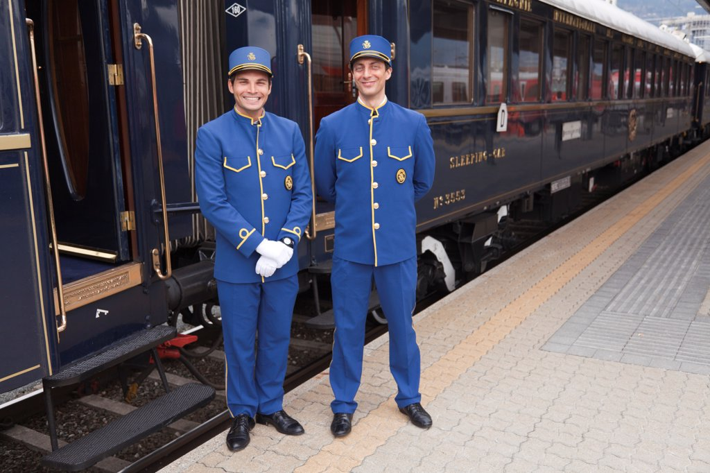 Stock Photo: 4272-41216 Stewards on the Venice Simplon Orient Express train, having a short stop at Innsbruck, Austria