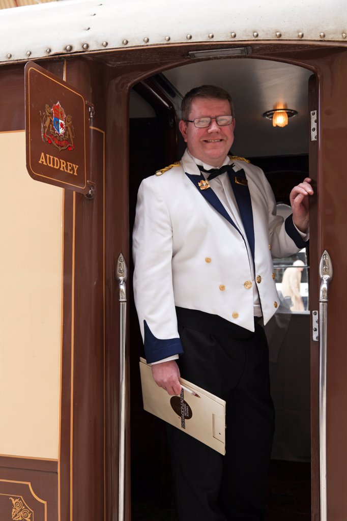 Stock Photo: 4272-41430 A steward on the British Pullman train, heading for Folkestone, England