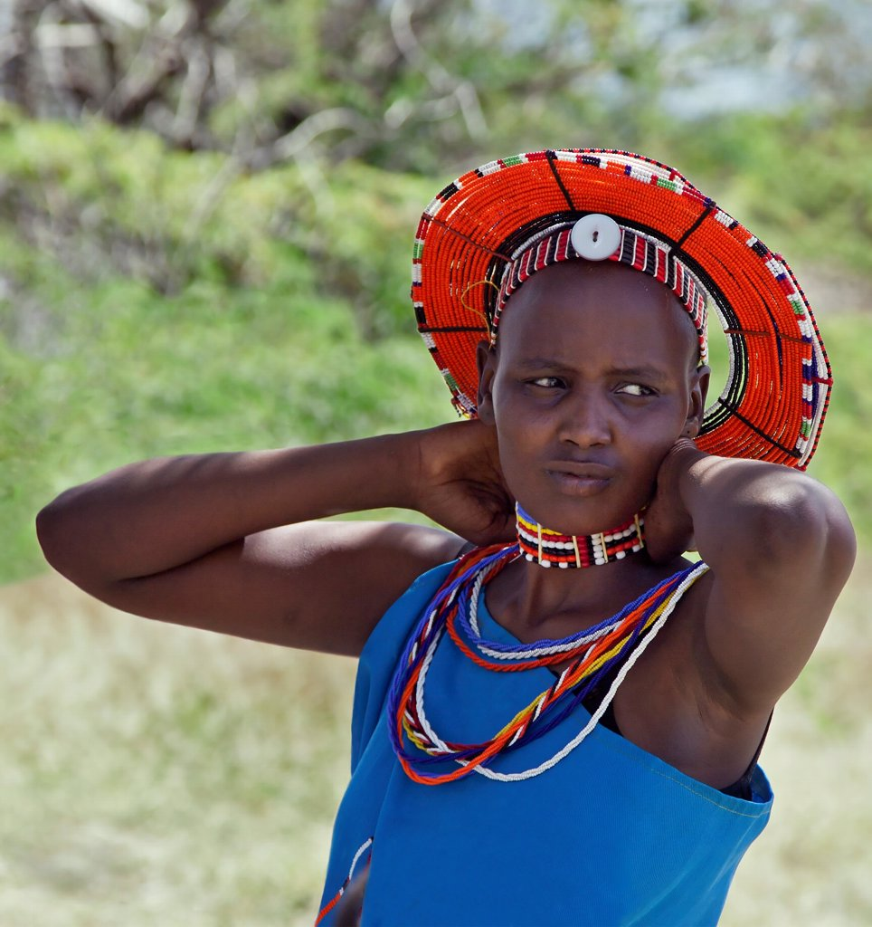 Stock Photo: 4272-42281 A Maasai schoolgirl relaxes during a practise for an inter schools song and dance competition at Magadi, Kenya