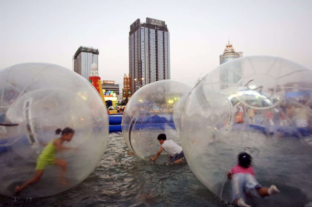 Stock Photo: 4272-4236 China, Shandong Province, Qingdao City. Amusement park at the Qingdao International Beer Festival. Qingdao is the host of the sailing events of the 2008 Olympic Games.