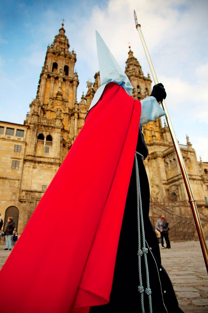 Santiago de Compostela, Galicia, Northern Spain, A nazareno walking in front of the Cathedral during Good Friday processions : Stock Photo