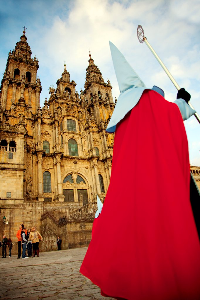 Stock Photo: 4272-42691 Santiago de Compostela, Galicia, Northern Spain, A nazareno walking in front of the Cathedral during Good Friday processions