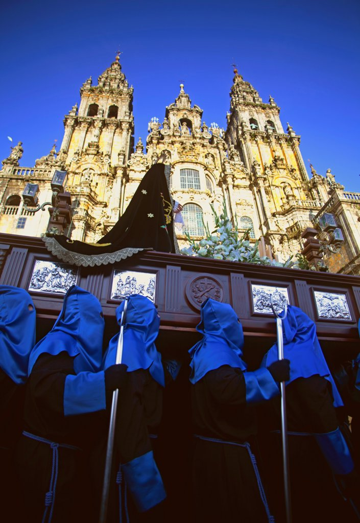 Stock Photo: 4272-42696 Santiago de Compostela, Galicia, Northern Spain, Nazzarenos carrying a statue of the Madonna in front of the Cathedral during Semana Santa