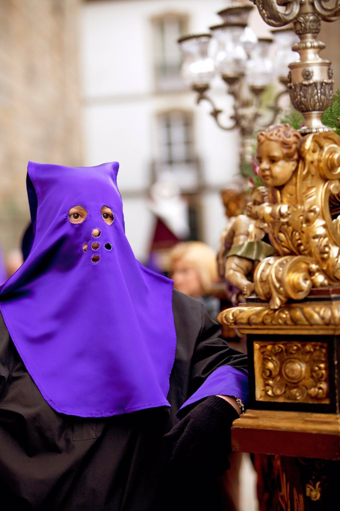 Stock Photo: 4272-42700 Santiago de Compostela, Galicia, Northern Spain, A nazarener resting before proceeding with the procession during Semana Santa
