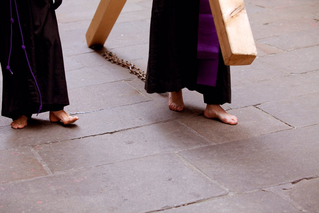 Santiago de Compostela, Galicia, Northern Spain, Detail of Nazareners bare feet carrying metal chains and cross during Semana Santa processions : Stock Photo