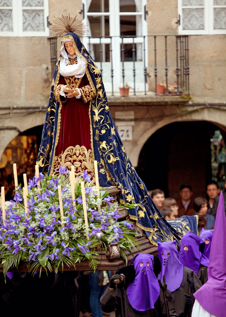 Stock Photo: 4272-42714 Santiago de Compostela, Galicia, Northern Spain, Nazarenos carrying statue during Semana Santa processions