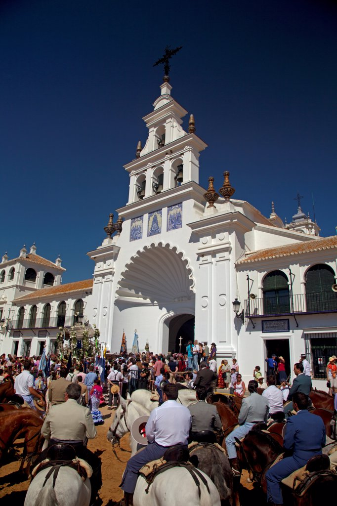 Stock Photo: 4272-43031 El Rocio, Huelva, Southern Spain. Man in traditional clothes on horseback in front of the main church in the village of El Rocio during the annual Romeria