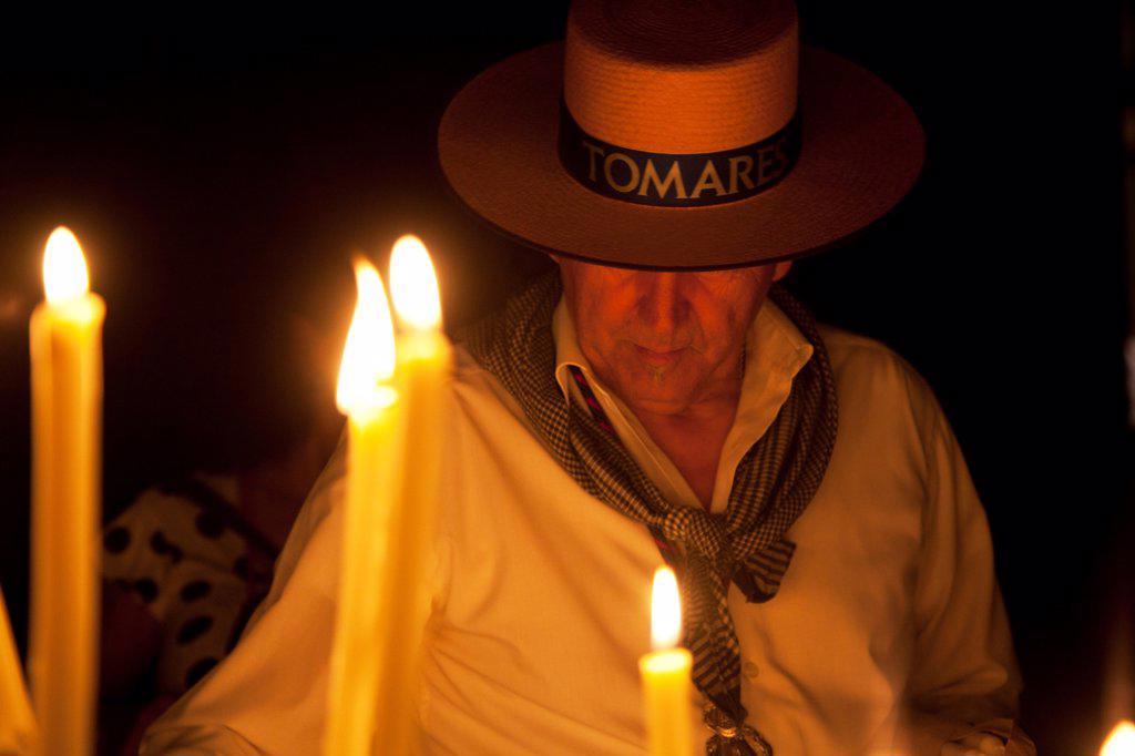 El Rocio, Huelva, Southern Spain; Believers lighting candles during the annual Romeria of El Rocio : Stock Photo