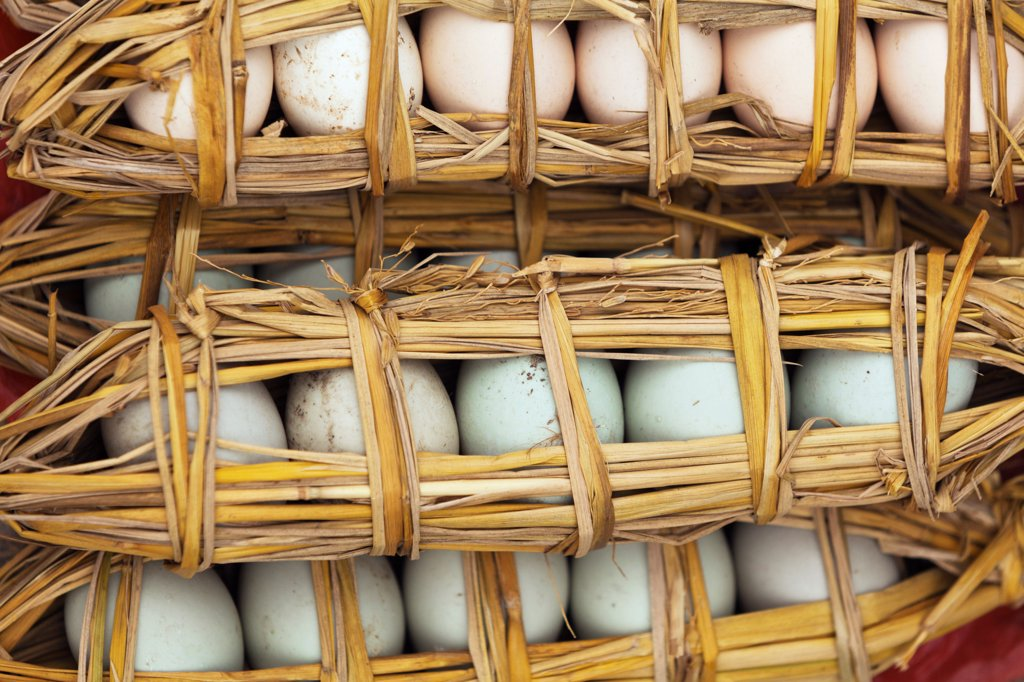 Stock Photo: 4272-43660 China, Yunnan, Yuanyang. Duck eggs wrapped in straw, Yuanyang.