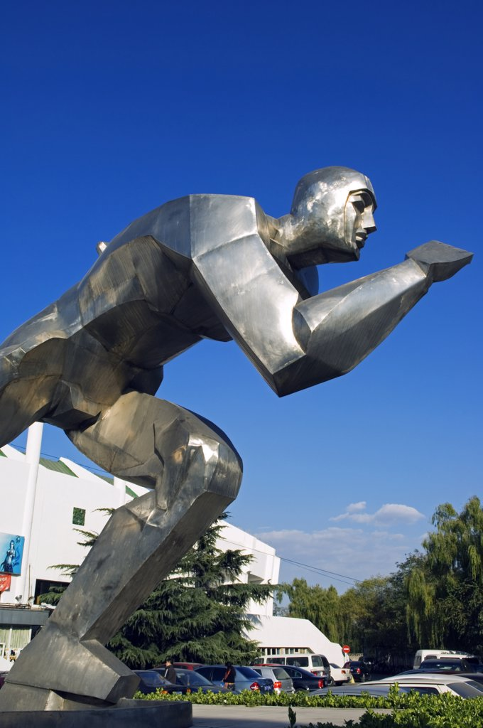 China, Beijing. A modern ice skater monument at the indoor ice skating training centre. : Stock Photo