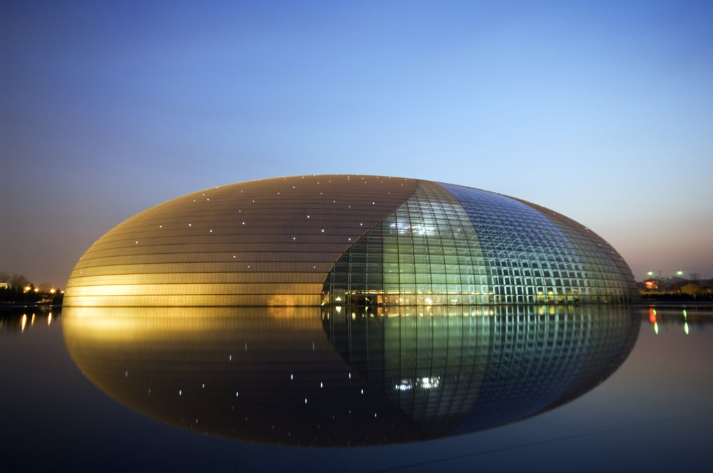 Stock Photo: 4272-4547 China Beijing An illuminated National Grand Theatre Opera House known as The Egg and designed by French architect Paul Andreu .
