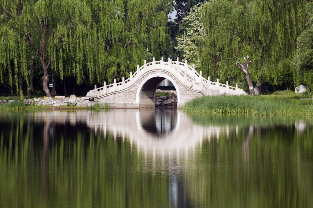 China, Beijing. Old Summer Palace - an arched stone bridge. : Stock Photo