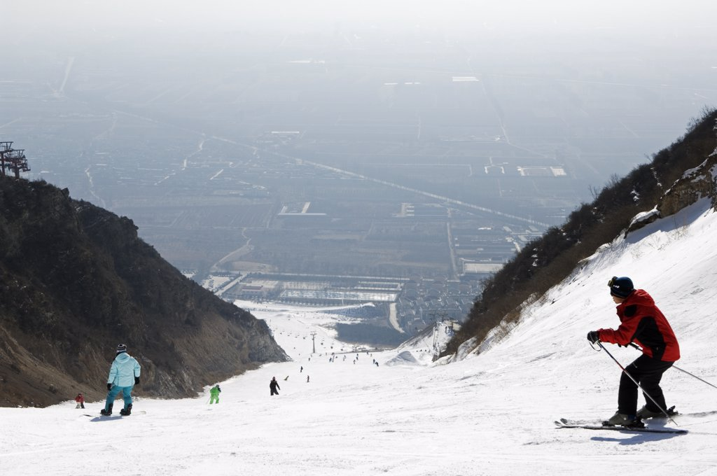 Stock Photo: 4272-4603 China, Beijing, Shijinglong ski resort. Skiers on the mountain.